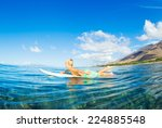 young boy surfing  paddling out ... | Shutterstock . vector #224885548