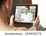 woman having video chat with... | Shutterstock . vector #224924173