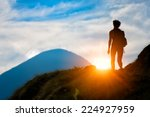 Trekking in silhouette - stock photo