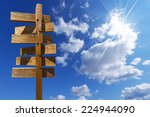 wooden sign on blue sky with...