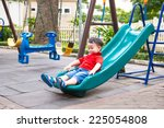 Happy Kids Playing On Slide....