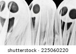 Three Ghost Figures