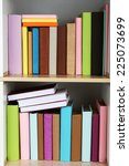 books on wooden shelves close up   Shutterstock . vector #225073699