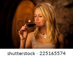 beautiful young woman tasting... | Shutterstock . vector #225165574