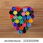 Small photo of Washable markers in a heart bowl. Close-up.