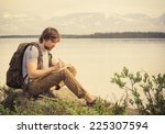 young man traveler with... | Shutterstock . vector #225307594
