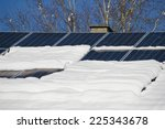 solar cells on a snowy roof | Shutterstock . vector #225343678
