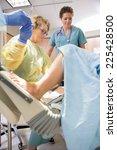 mature female surgeon receiving ... | Shutterstock . vector #225428500