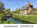 House With Thatched Roof In...