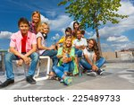 happy friends sit on chairs of... | Shutterstock . vector #225489733