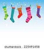 christmas stockings in winter ... | Shutterstock .eps vector #225491458