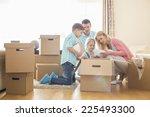 Family Unpacking Cardboard...