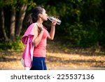 a girl drinks water after sport | Shutterstock . vector #225537136