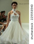Small photo of NEW YORK, NY - OCTOBER 09: A model walks the runway at the Della Giovanna Bridal Runway Show during Fall 2015 Bridal Collection at the Alchemical on October 09, 2014 in New York City.