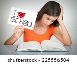 Girl Studying And Holding A...
