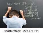 Frustrated at the new math. - stock photo