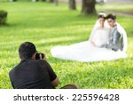 wedding photographer in action | Shutterstock . vector #225596428