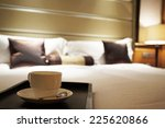 Stock photo luxury bedroom with cup of coffee 225620866