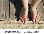 women foots on the beach. pink... | Shutterstock . vector #225626554