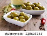 marinated olives on table close ... | Shutterstock . vector #225638353