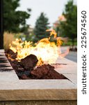 An Outdoor Fireplace Burning A...