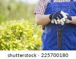midsection of gardener holding... | Shutterstock . vector #225700180