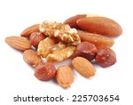 Various Nuts On White Fabric
