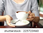 cup of coffee holding on hand. | Shutterstock . vector #225723460