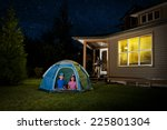Small photo of a backyard campout / for excited little kids / with help from mommy