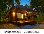 beach bungalow at sunset  ... | Shutterstock . vector #225810268
