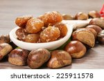 Small photo of Chestnuts and marron glace over a light brown background