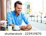 happy young man browsing... | Shutterstock . vector #225919870