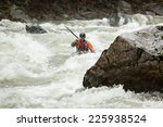 Man Kayaking Down A Section Of...
