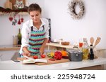 young woman reading cookbook in ...   Shutterstock . vector #225948724