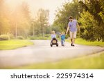 happy young father with his two ... | Shutterstock . vector #225974314