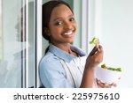 Beautiful African Girl Eating...