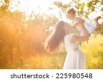 happy young pregnant mother and ... | Shutterstock . vector #225980548
