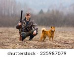 hunter with a dog on the field | Shutterstock . vector #225987079