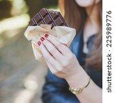 Girl Eating A Bar Of Chocolate...