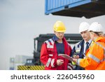workers discussing over... | Shutterstock . vector #226045960