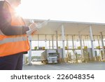 midsection of female worker... | Shutterstock . vector #226048354