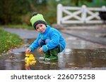 little boy  jumping in muddy...   Shutterstock . vector #226075258
