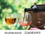 red wine pouring into wine... | Shutterstock . vector #226083493