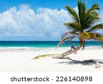 little boy sitting on palm at... | Shutterstock . vector #226140898