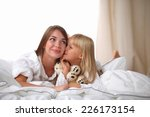 woman and young girl lying in... | Shutterstock . vector #226173154