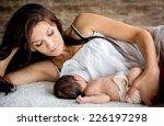 Beautiful Mother Feeding Her...