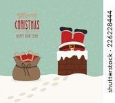 santa stuck in chimney gift bag ... | Shutterstock .eps vector #226228444