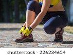 runner woman training in city... | Shutterstock . vector #226234654