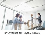 businesspeople shaking hands in ... | Shutterstock . vector #226243633