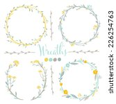 Four vector floral wreaths. Hand drawn design elements set.